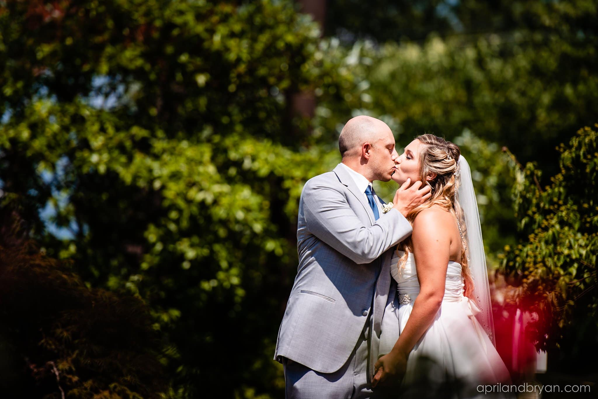 bride and groom kissing at the eden resort